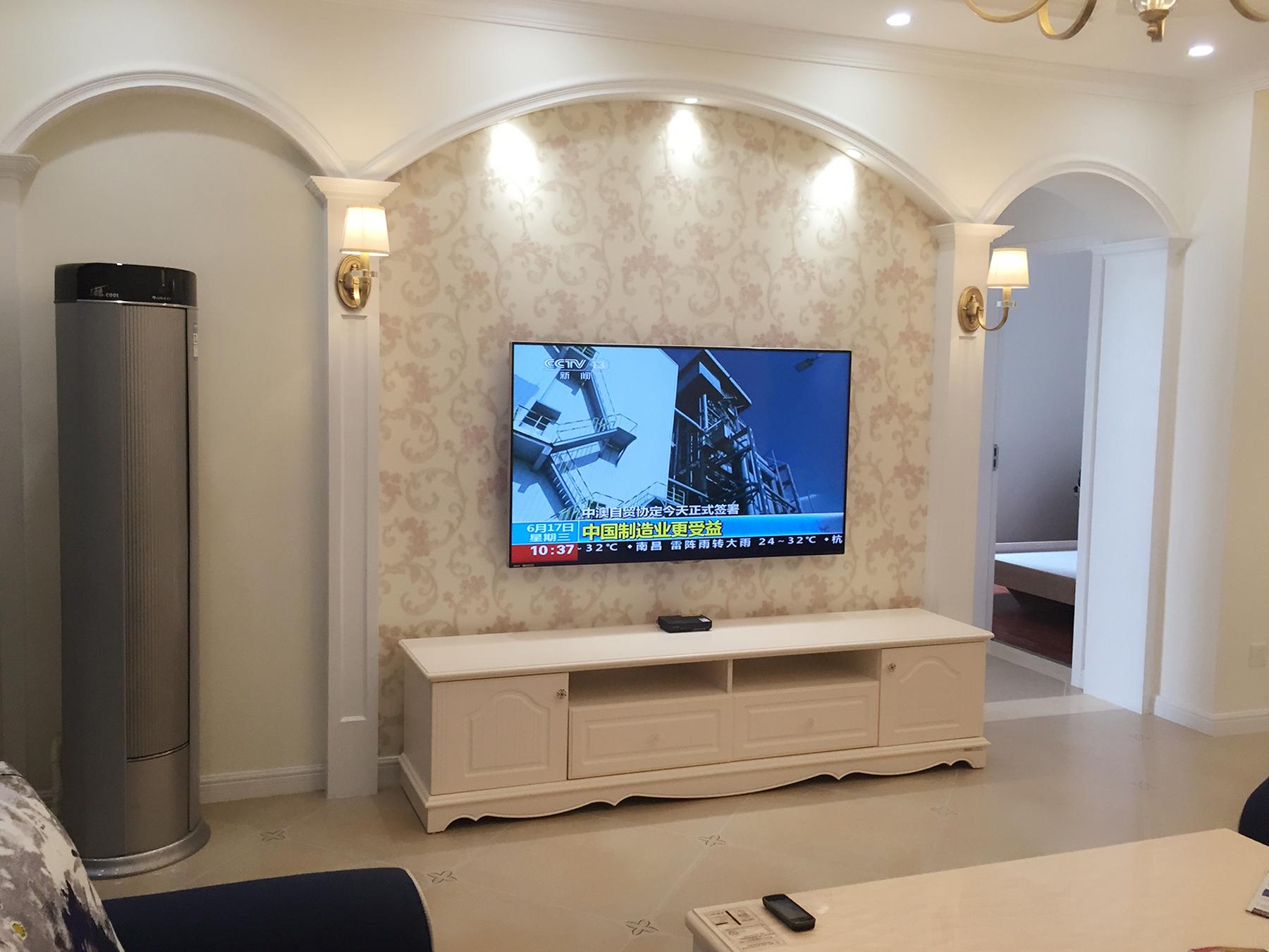 圆拱形的电视背景墙造型设计